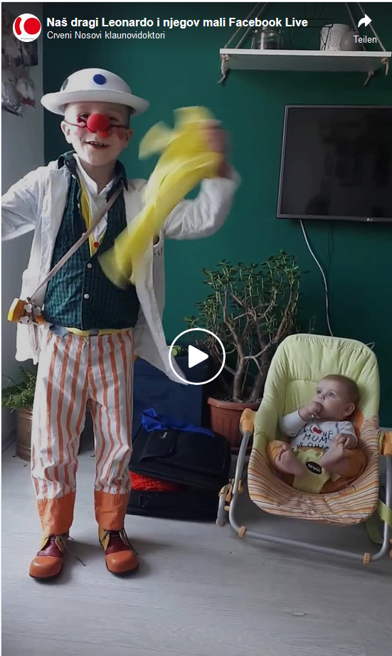 Leo is online performing a small clown show and his baby brother is next to him in the room watching him closely.