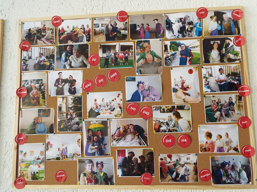 A big wallpaper joins together a collection of pictures of elderly people and RED NOSES Lithuania clowns