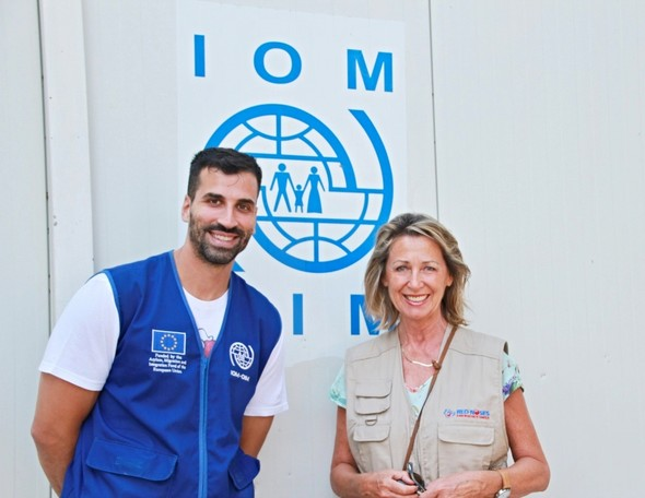 Monica Culen, RED NOSES International founder, stands next to an IOM male staff member.